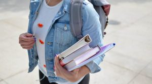 Student carrying their books.