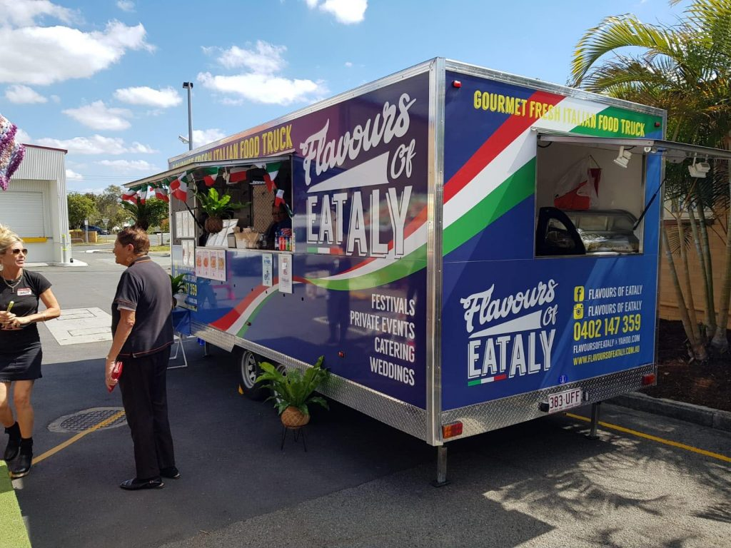 A food truck serving customers