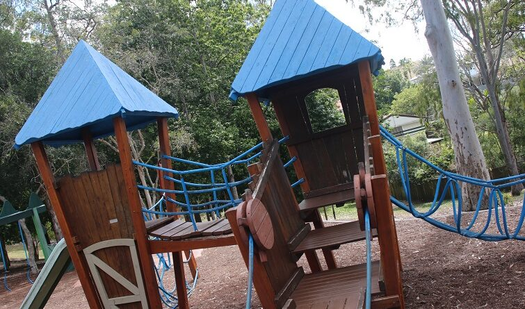 Kids playing on the play castle at Majestic Park