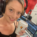 Shayne Rudd in the USQ Radio Studios holding a takeaway coffee.