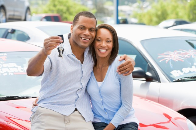 couple showing car keys